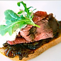 Thinly Sliced Rare Beef Tenderloin with Onion Jam