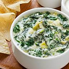 Warm, Creamy Spinach and Artichoke Dip with Tortilla Chips