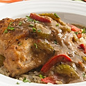 Smothered Chicken featuring Andouille and Tri-Colored Peppers