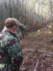 Combat sniper in the prone postion wearing his ghillie suite with his L96 airsoft sniper rifle.