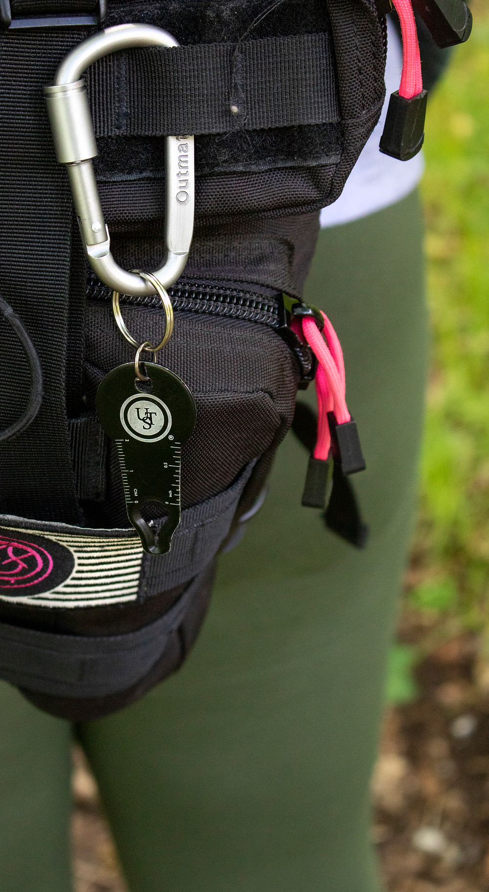 Tick puller hanging from backpack