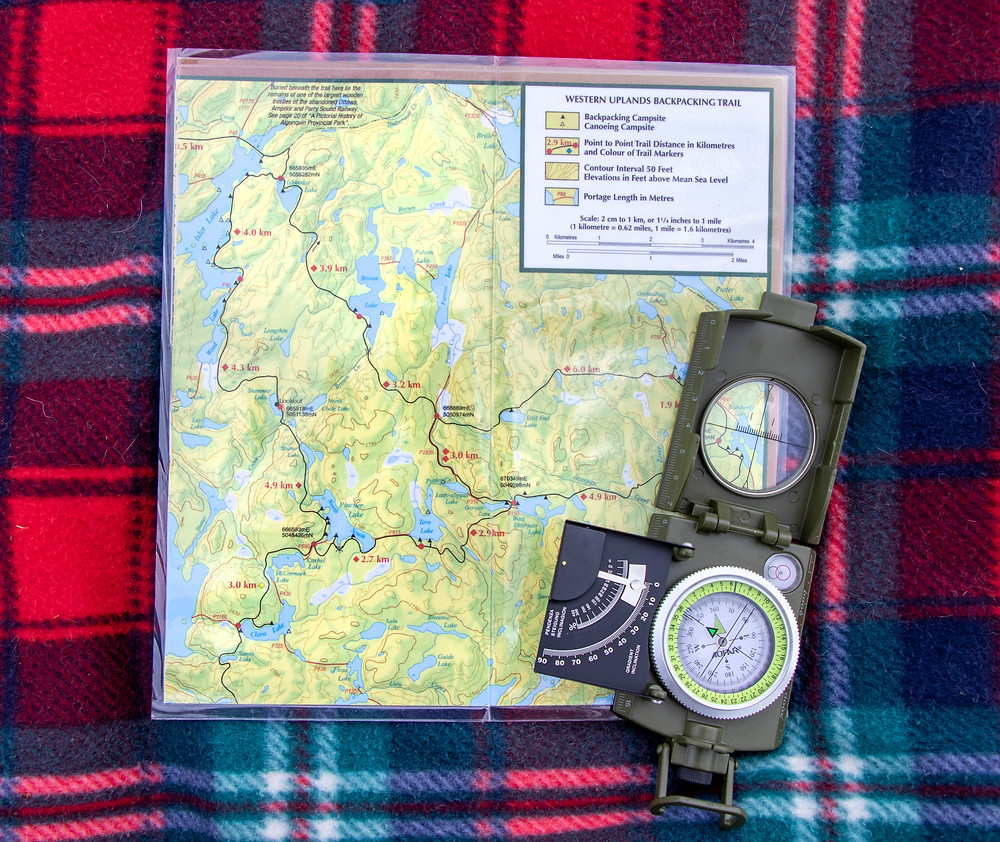 Map with compass laying on top of it