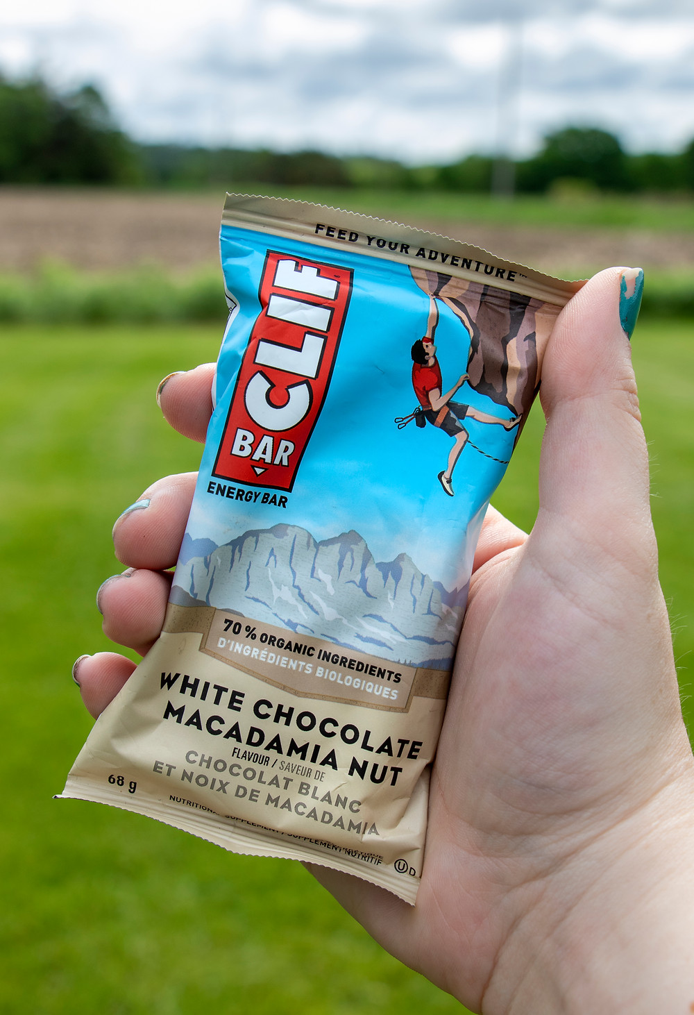 Someone holding a Clif Bar