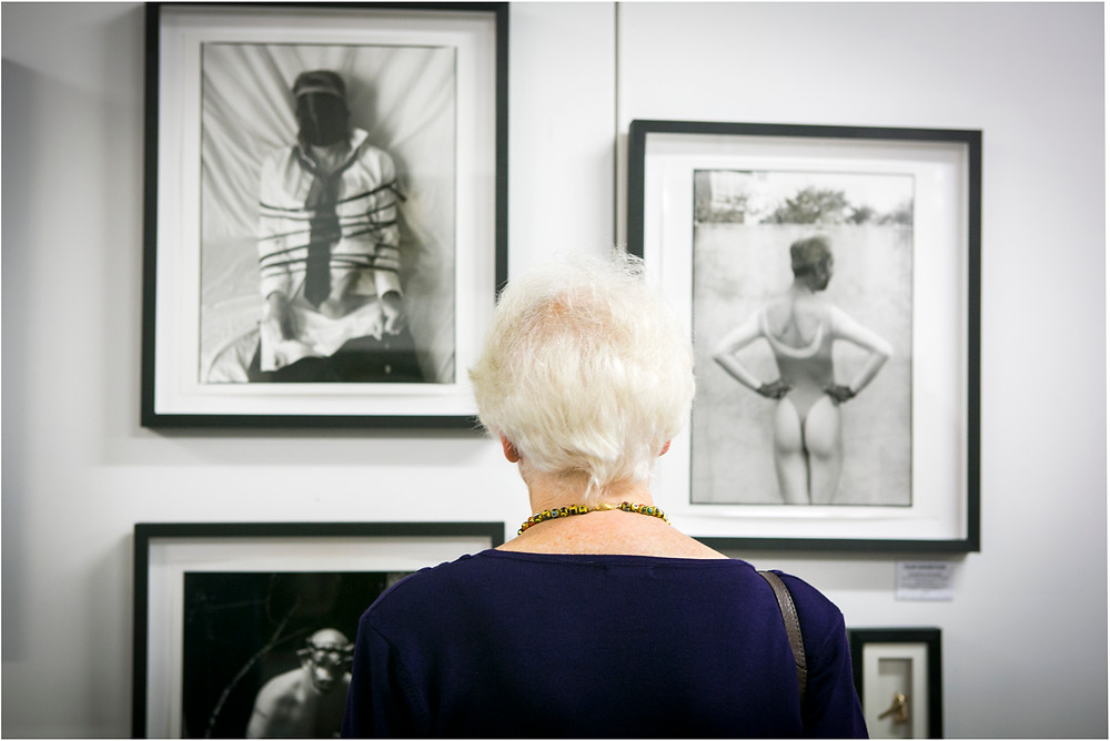 "Old lady is looking at 'James, the businessman""black and white picture"