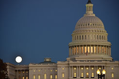 the-us-capital-building-at-night-with-a-full-moon--SQRHMJQ.jpg
