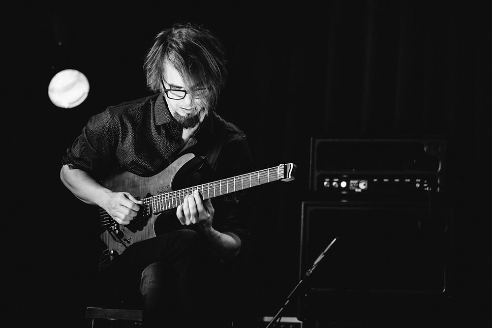 Alex Machacek playing guitar