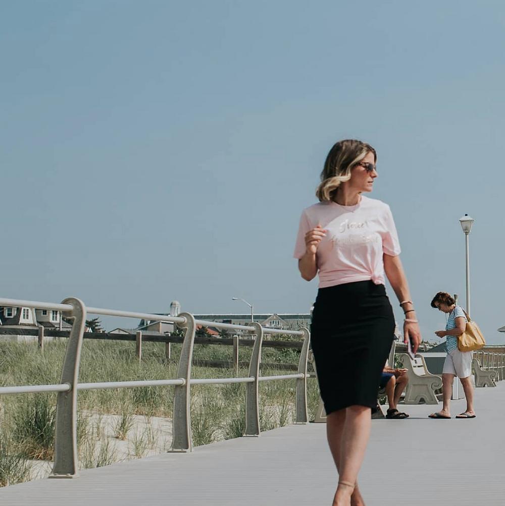 Tamara walking by the beach