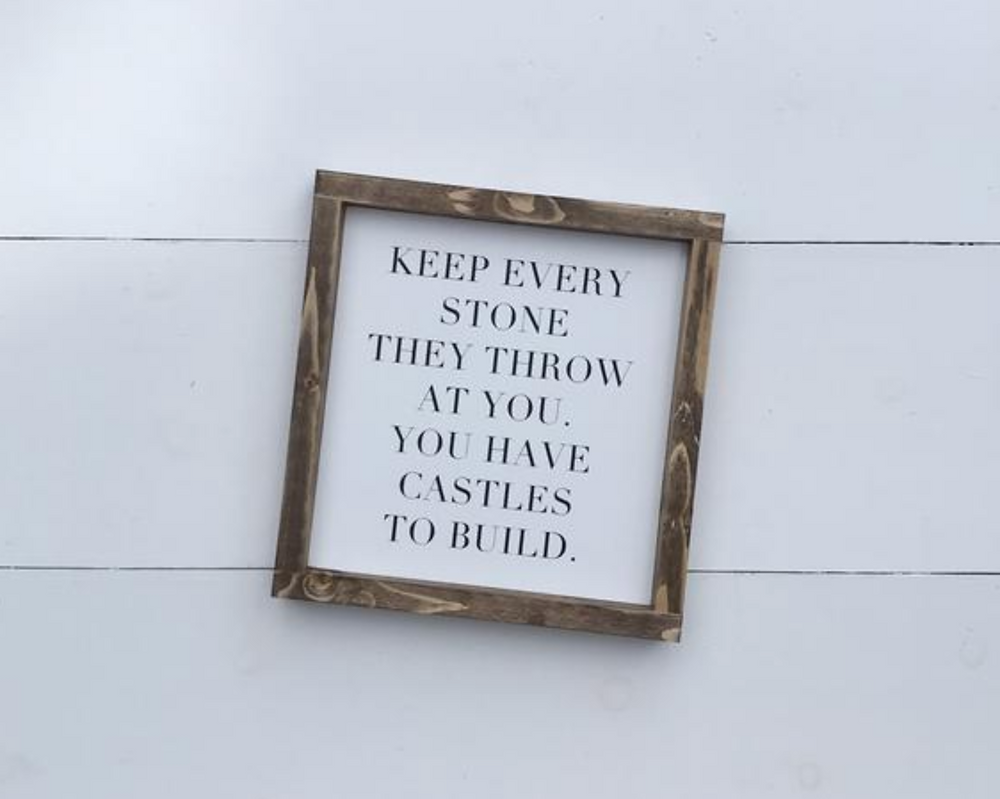 Keep ever stone they throw at you, you have castles to build quote sign