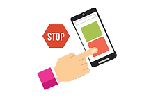 Hand holding phone with stop sign