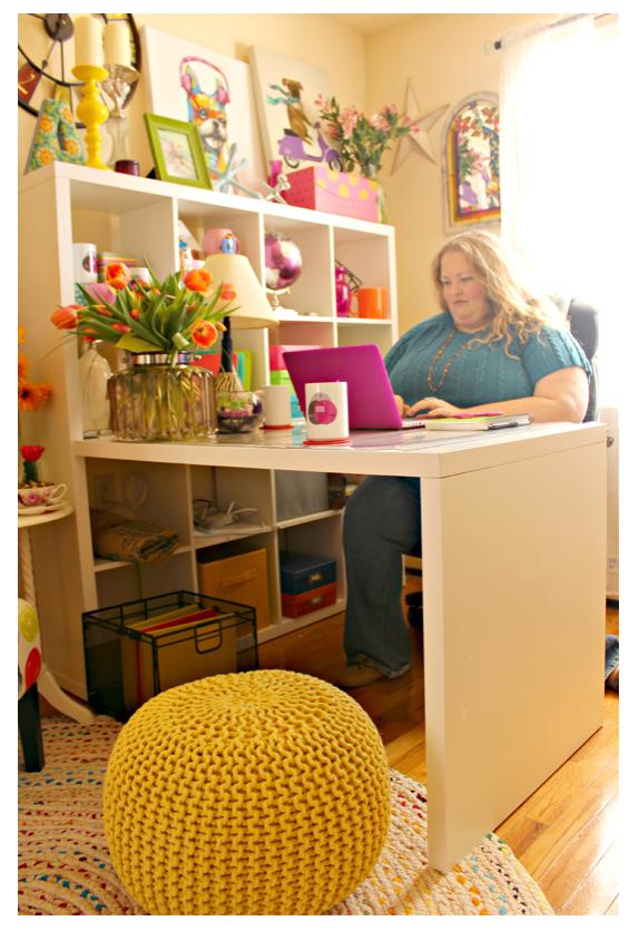 Alycia Yerves sitting at home office desk