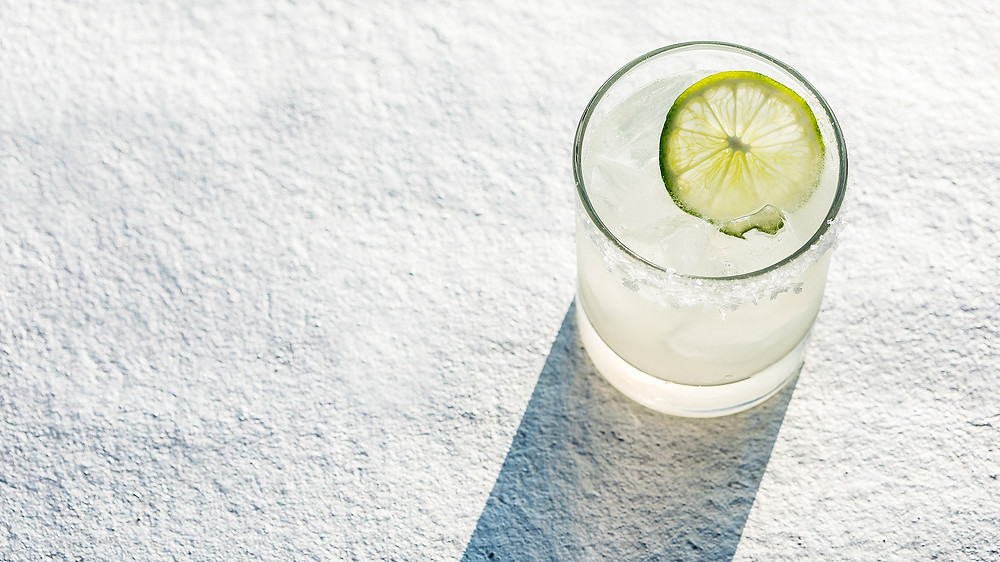 Tequila on the rocks with lime