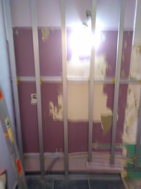 E) Doublage des murs
