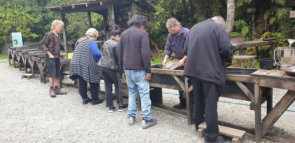 Kerry Groves helping people with the art of gold panning