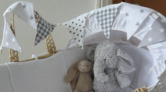 Pebbles bunting is a gentle mix of neutral greys and whites...