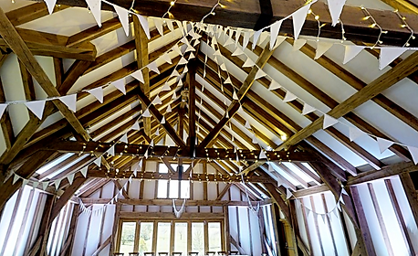 Our fabulous Lace & Pearls bunting in rustic barn setting