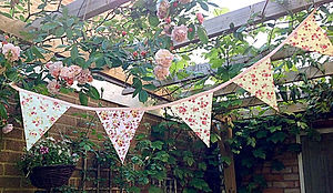 Rambling Rose bunting captures all the charm and fragrance of an English country garden.