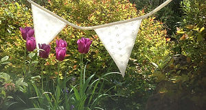 Our beautiful, ivory Victoria bunting is ideal in a barn setting.