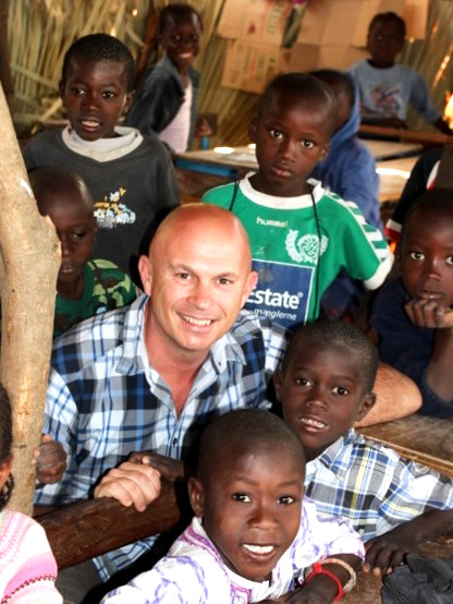 Doug Manuel with children whose studies in Abéné, Senegal are supported by Lighting Up Lives.