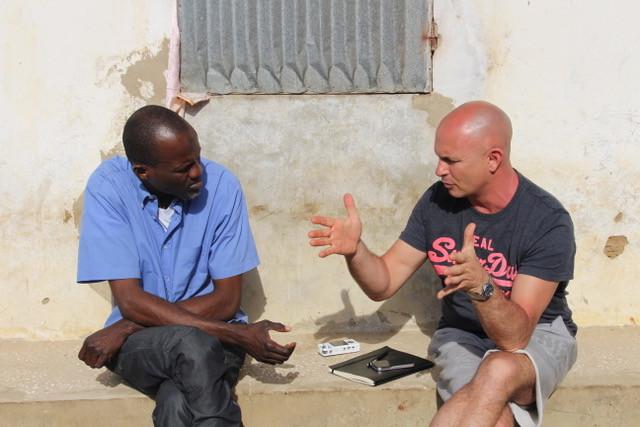 Doug Manuel confers with Bakary Diem, associate director of the Alumna Djabba School in Abéné, Senegal.