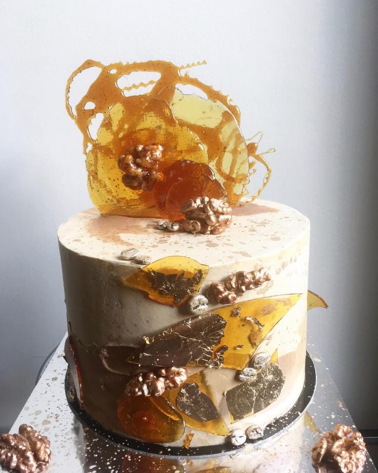 coffee, walnut praline, french meringue buttercream, caramel decorations