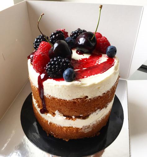 vanilla cake, vanilla buttercream, lemon rose syrup, fresh berries, mixed berry coulis