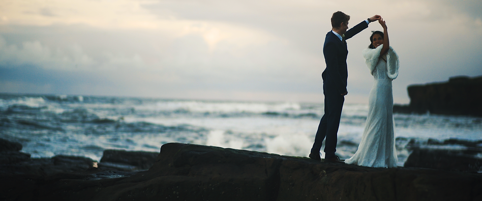 married couple dance on rocks