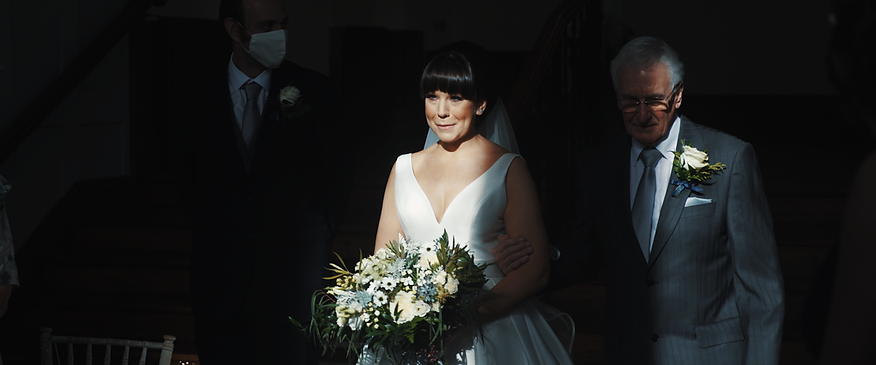 bride walking in to light at thicket priory