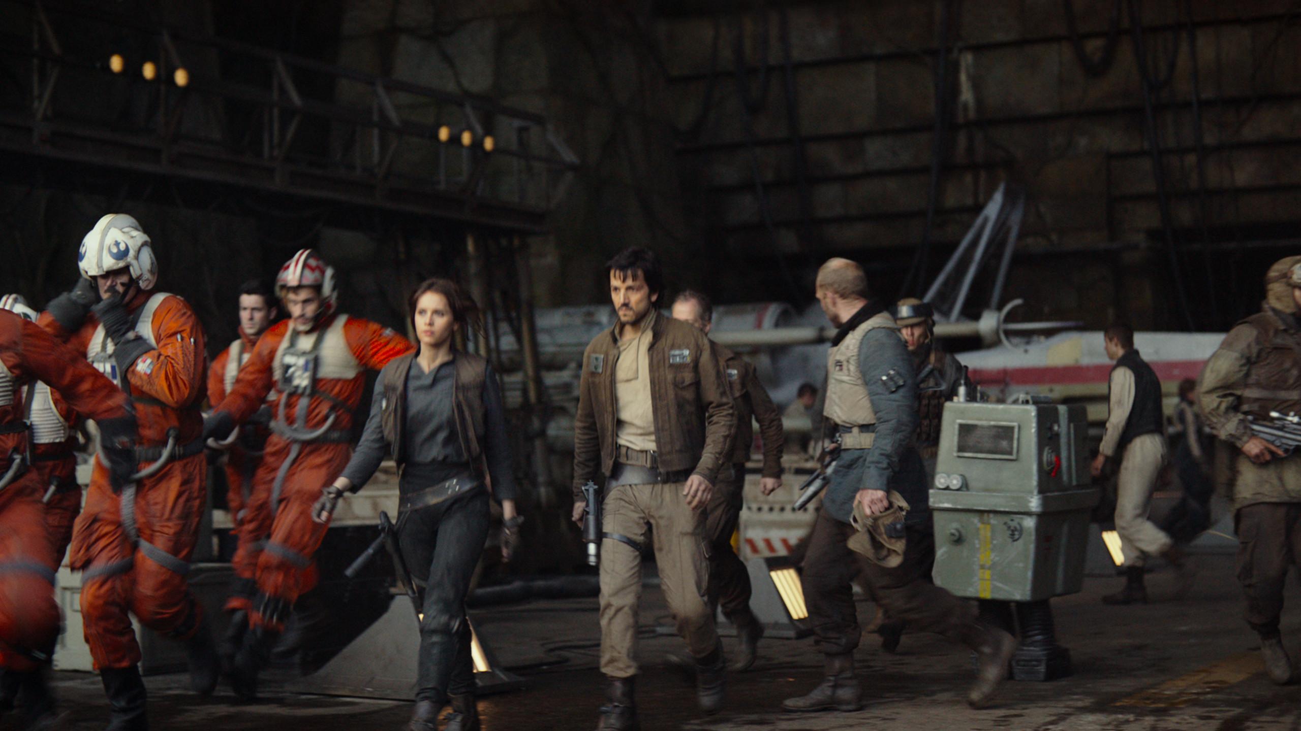 Felicity Jones and Diego Luna march into battle.