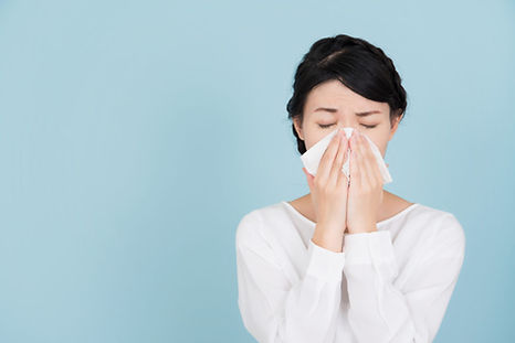 Woman Blowing Nose with Nasal and Sinus Troubles
