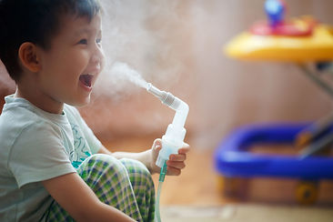 Happy child with nebulizer treating asthma