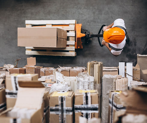 young-man-working-at-a-warehouse-with-bo