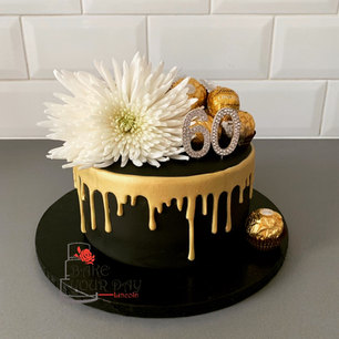 Black and Gold Dripcake.jpeg