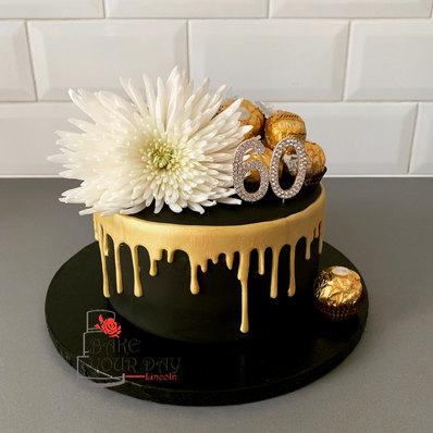 Black and Gold Dripcake.jpeg
