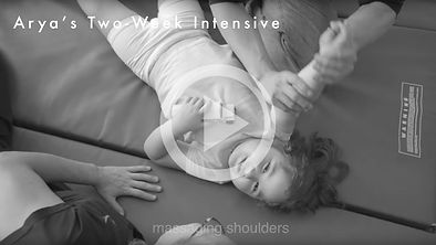 A young girl with a disability receives bodywork from an adapted spiral praxis practitioner in a private intensive