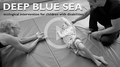 Two instructors teach bodymind awareness to a young child with cerebral palsy in a private intensive