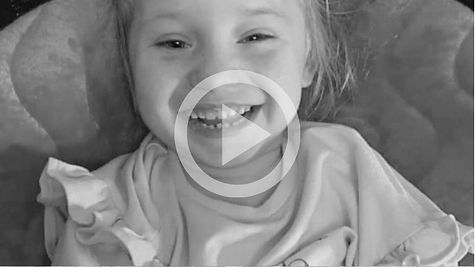 A young girl from the UK with the rare genetic condition AADC is photographed smiling for an ITV news report