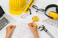 hand-over-construction-plans-with-yellow