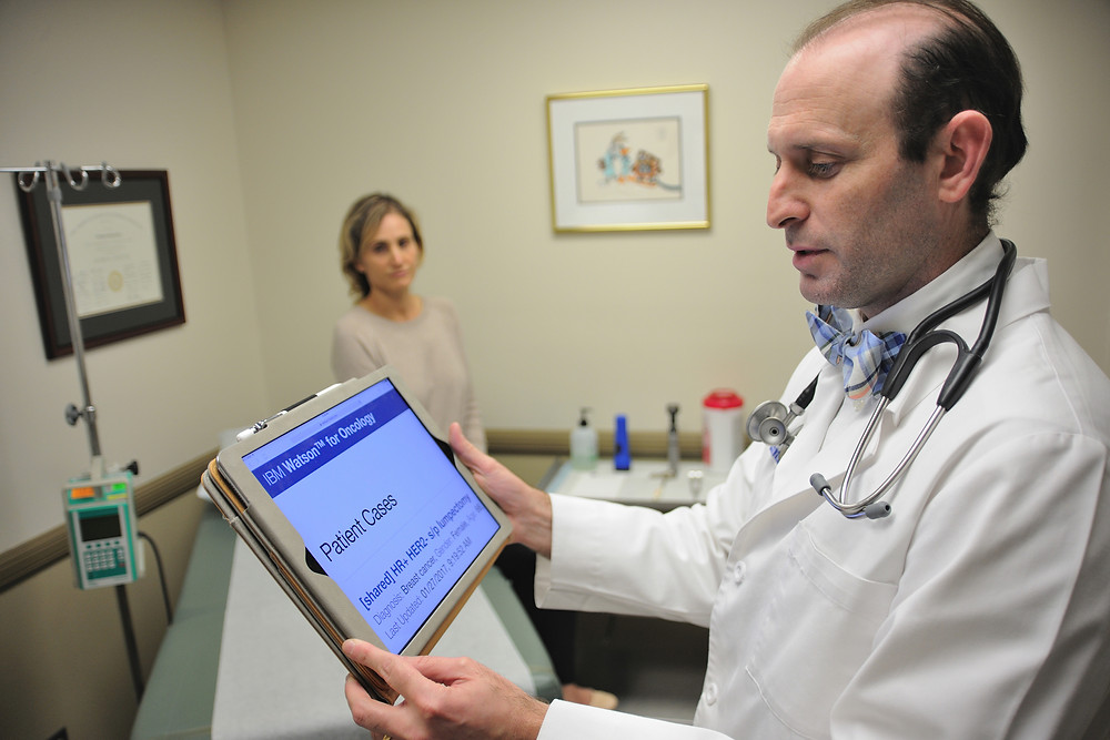 Dr. Abraham Schwarzberg, MD, chief of oncology at Jupiter Medical Center in Palm Beach County, Florida, reviews recommendations generated by IBM Watson for Oncology. (Image Courtesy of Jupiter Medical Center)