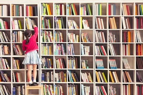 elementary grade girl searching for books