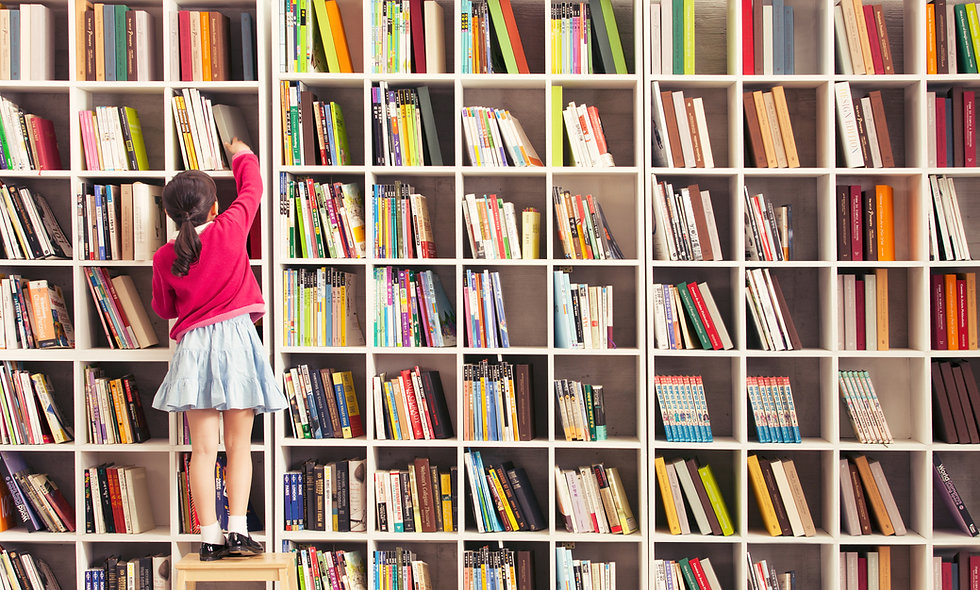 Girl on stool reaching for books library learning online education classes for kids homeschool affordable child interactive