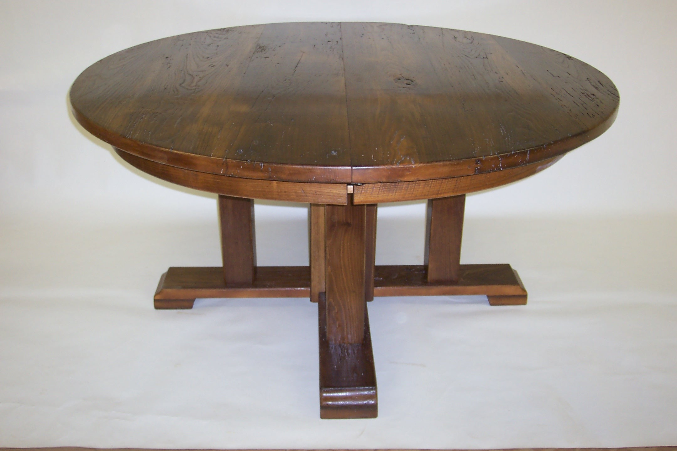 round chestnut trestle table