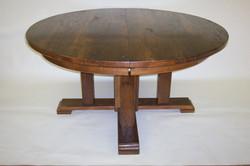 round chestnut trestle table