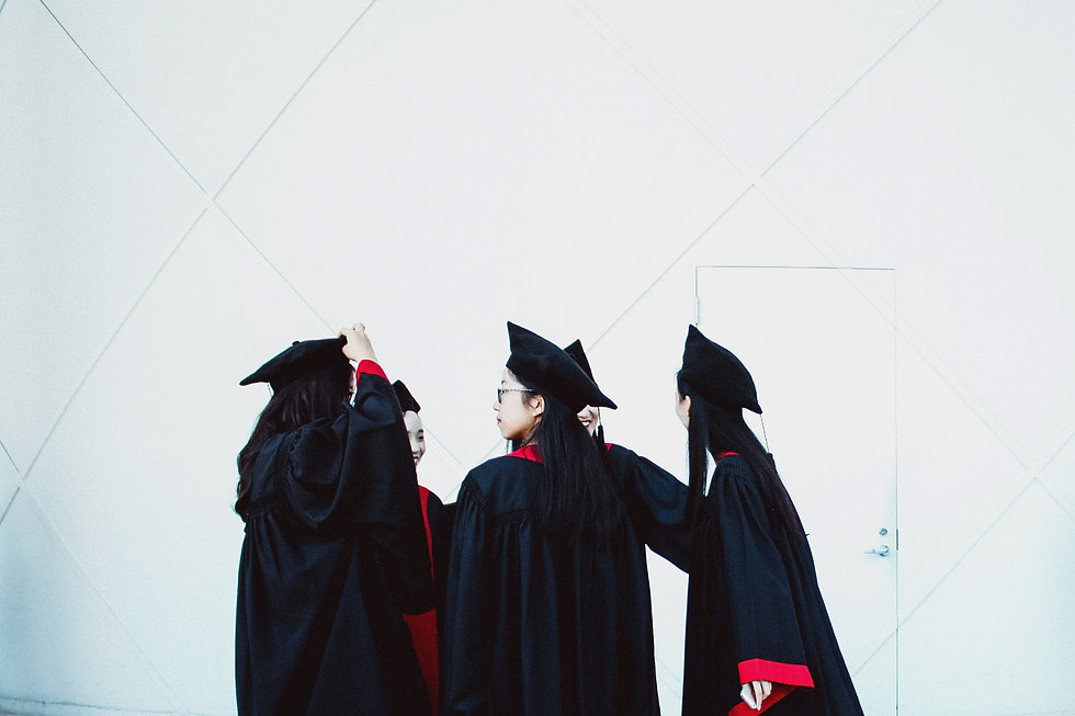 Women graduates standing together, considering their next steps in their career. Women in international affairs, global development, foreign policy, human rights, international trade.