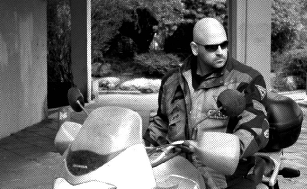 An intimidating biker sits on his motorcycle