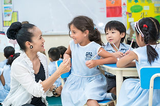 student with teacher assistant laughing