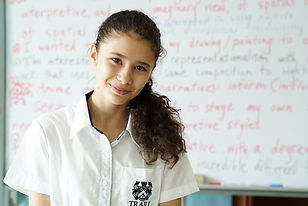 smiling student in front of equations maths