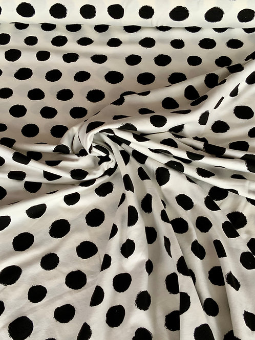 Dots on white cotton jersey