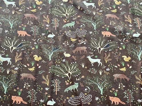 Forest animals on brown cotton jersey