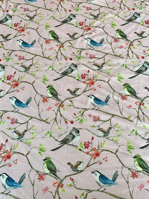 Spring birds on pink cotton jersey