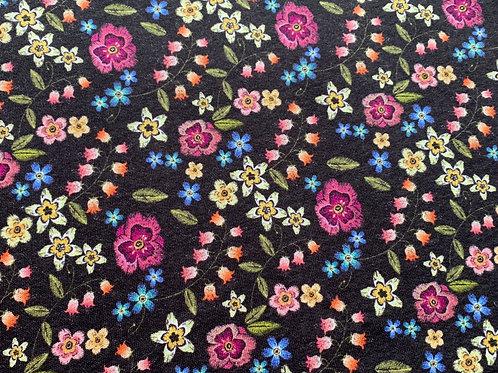 Autumnal flowers on dark brown sweat